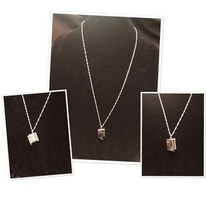 Sterling silver sweater chain with locket.